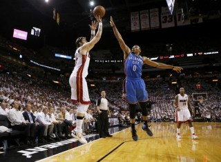 Miami Heat's Miller shoots over Oklahoma City Thunder's Westbrook during the first quarter in Game 5 of the NBA basketball finals in Miami